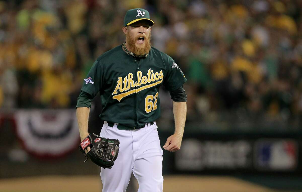 A's pitcher Sean Doolittle, (62) strikes out Omar Infante, (4) to end the ninth inng, on Friday Oct. 4, 2013, in Oakland, Calif. at O.co Coliseum, as the Oakland Athletics fall 3-2 to the Detroit Tigers in game one of the MLB American League Division Series.