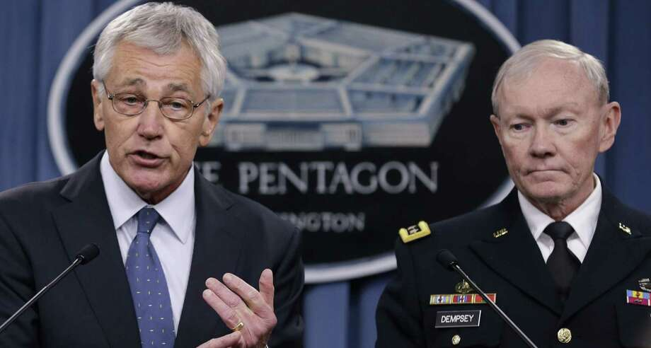 Defense Secretary Chuck Hagel, with Joint Chiefs Chairman Gen. Martin Dempsey, briefs reporters Monday at the Pentagon, where he revealed plans for the president's 2015 budget. Photo: Carolyn Kaster / Associated Press / AP