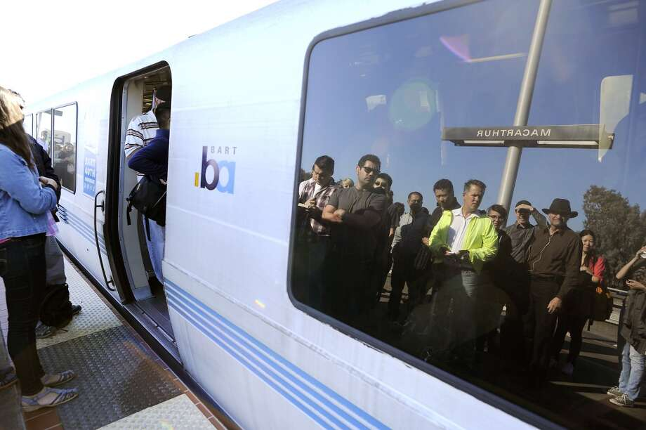 Resist the urge to smother the person whose body odor is being amplified tenfold by the tropical climate of the BART train. Photo: Michael Short, Special To The Chronicle