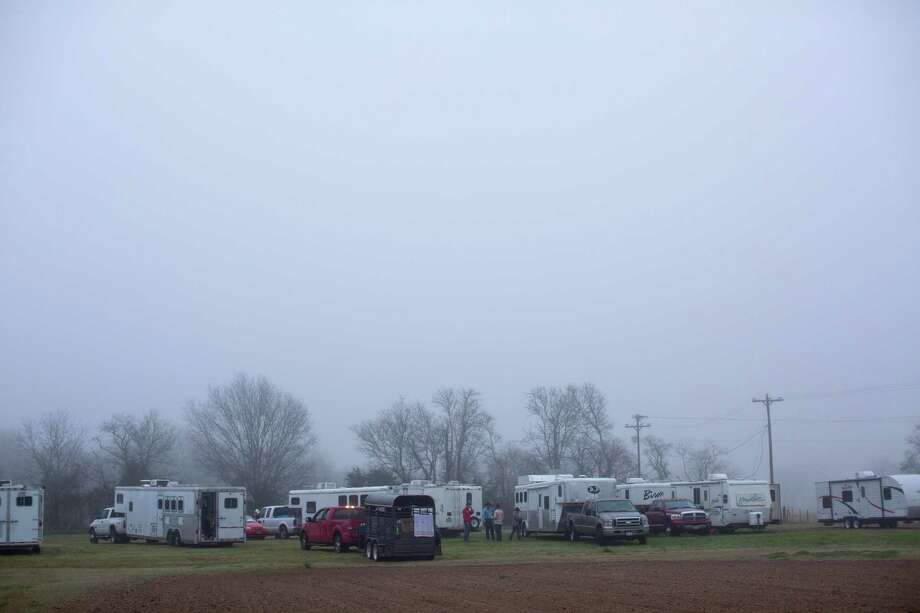 The Texas Independence Trail Ride participants park their trailers around 6:45 a.m. at Alvin Youth Livestock Arena Association. Photo: Marie D. De Jesús, Houston Chronicle / © 2014 Houston Chronicle