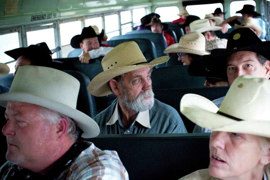 Mike Craig, center, and fellow riders of the Texas Independence Trail Ride take a bus from the Alvin Youth Livestock Arena Association, where they left their trailers, to head to the Alvin Rotary Club. Photo: Marie D. De Jesús, Houston Chronicle / © 2014 Houston Chronicle