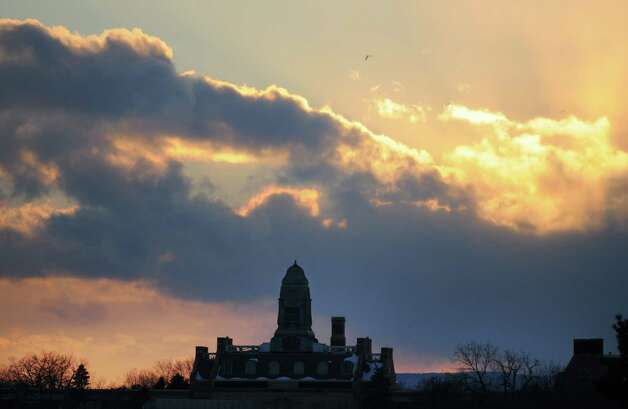 Philip Livingston Magnet Academy is backlit by a brilliant sunset Monday afternoon, Feb. 24, 2014, in Albany, N.Y. (Will Waldron/Times Union) Photo: WW / 00025849A
