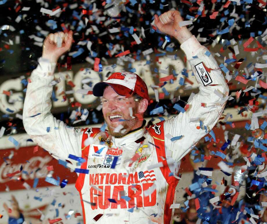 Dale Earnhardt Jr. celebrates in Victory Lane after winning the NASCAR Daytona 500 Sprint Cup series auto race at Daytona International Speedway in Daytona Beach, Fla., Sunday, Feb. 23, 2014. (AP Photo/Terry Renna) ORG XMIT: DBR156 Photo: Terry Renna / FR60642 AP