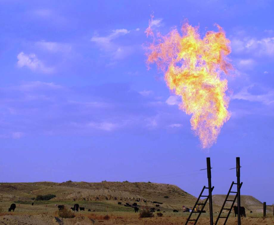 An oil-drilling boom has transformed parts of North Dakota making natural gas flares at drilling operations like this one near Trenton, N.D., a common sight. Photo: McClatchy-Tribune News Service / MCT