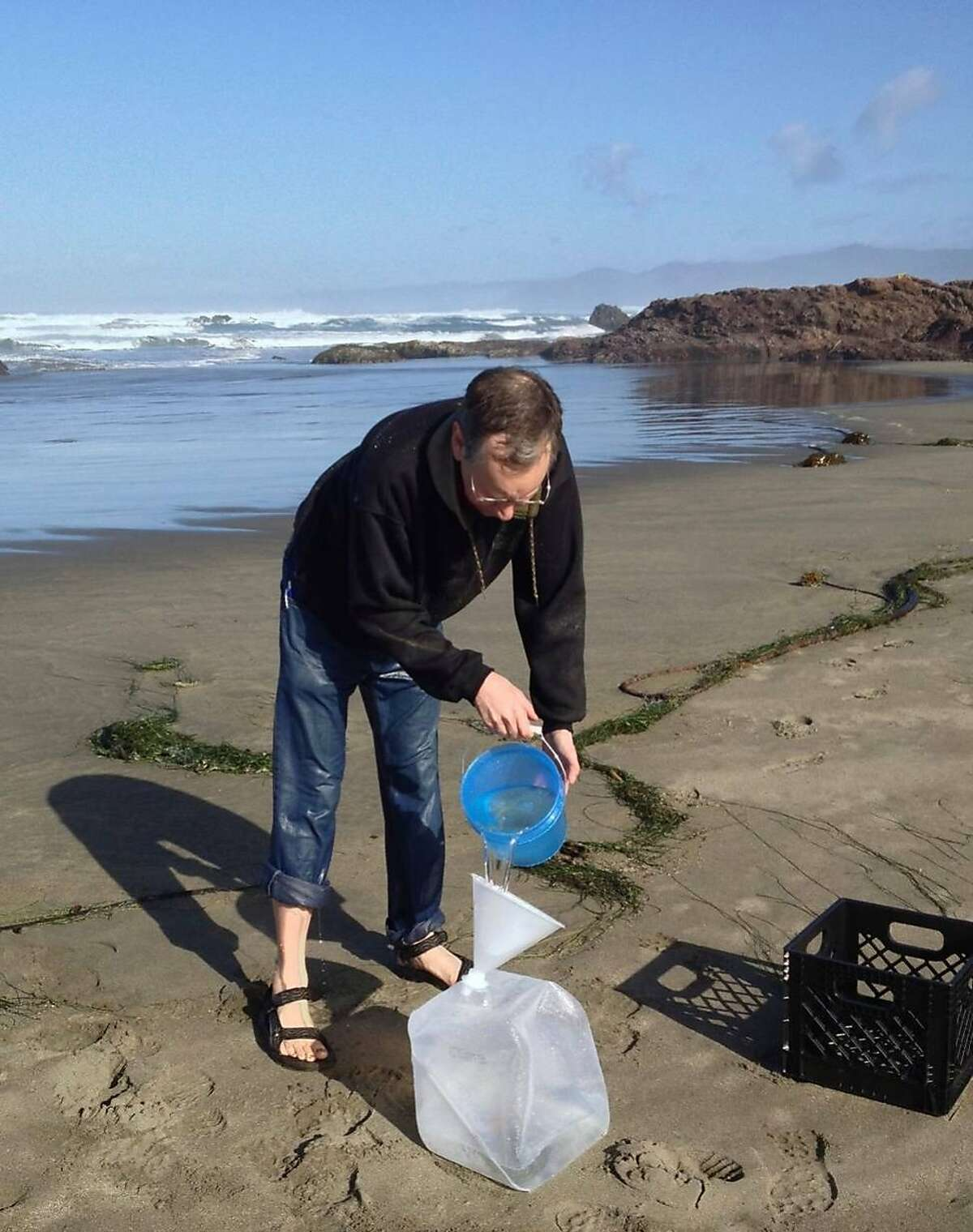 Dr. Roger Gilbert collects seawater near Fort Bragg in an effort to monitor for radiation contamination.