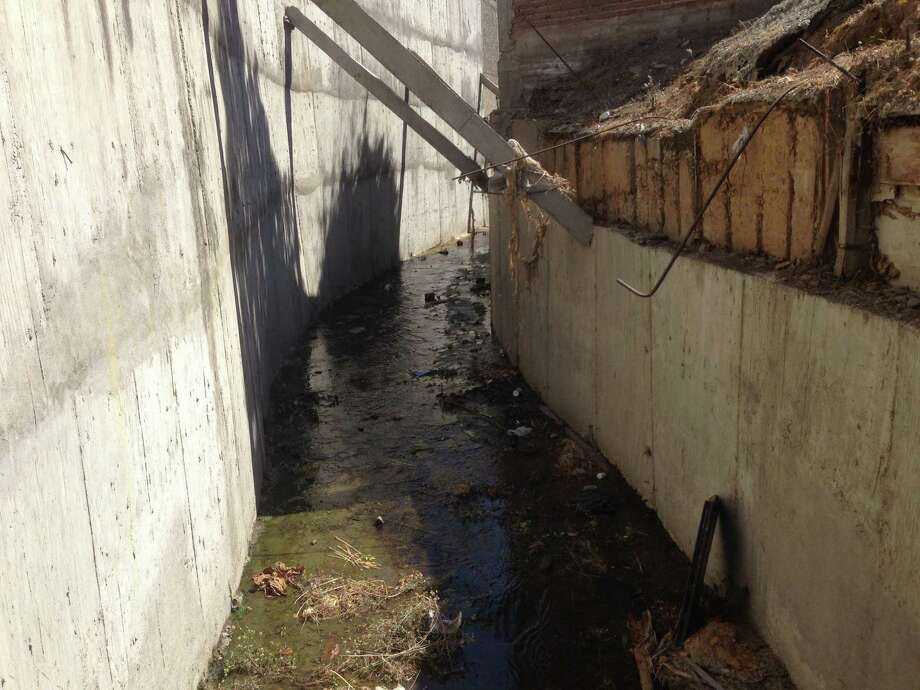 """Drug lord Joaquin """"El Chapo"""" Guzman escaped his captors by walking along this drainage canal and tunnel behind a house in Culiacan, Mexico, last week. Guzman was finally captured on Saturday in the nearby city of Michoacan. Photo was taken Feb. 24, 2014. (Tim Johnson/MCT) Photo: Tim Johnson, McClatchy-Tribune News Service / MCT"""