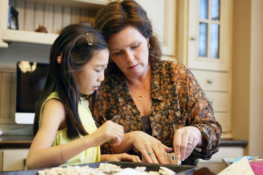 Eight-year-old Liping Sheridan builds a model with her mother, Kathleen O'Rourke, who battled Lyme disease for years. Photo: Codi Mills, The Chronicle