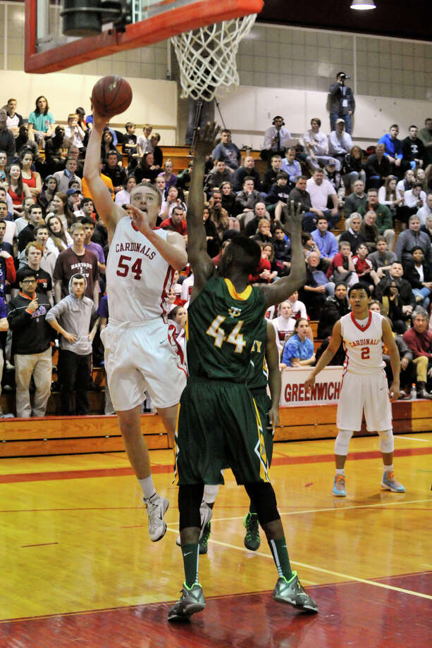 Greenwich's Alex Wolf shoots over Trinity Catholic's Peace Ilgomah during their basketball game at Greenwich High School in Greenwich, Conn., on Monday, Feb. 24, 2014. Greenwich won, 59-58 in overtime. Photo: Jason Rearick / Stamford Advocate