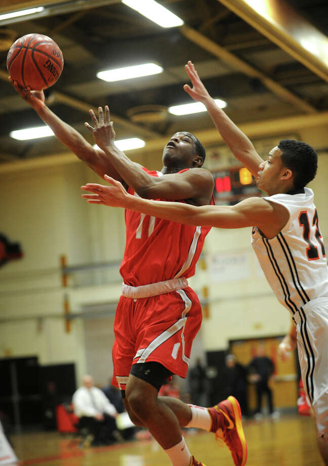 Bridgeport Central's Tyler Ancrum drives to the basket against Stamford defender Gianni Carwin during their FCIAC boys basketball game at Stamford High School in Stamford, Conn. on Monday, February 24, 2014. Photo: Brian A. Pounds / Connecticut Post