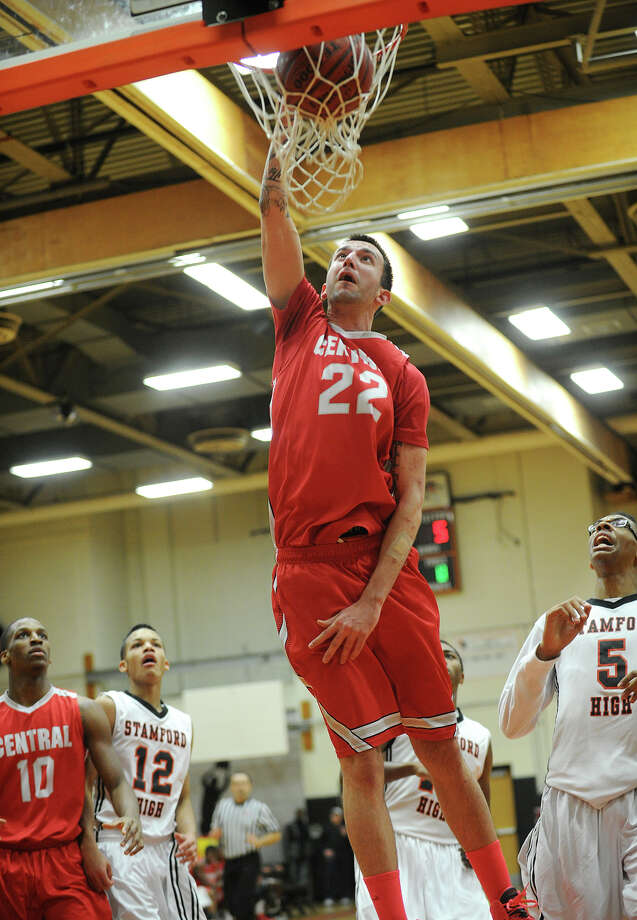 Bridgeport Central's Orhan Cecunjamin rises up for a dunk  during their FCIAC boys basketball game at Stamford High School in Stamford, Conn. on Monday, February 24, 2014. Photo: Brian A. Pounds / Connecticut Post