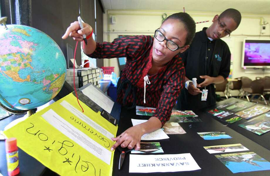 Chisom Anyanwu, 15, left, and Blake Gomez, 14, work on a project about Laos at the HISD's Energy Institute High School  last week.   Photo: Melissa Phillip, Staff / © 2014  Houston Chronicle