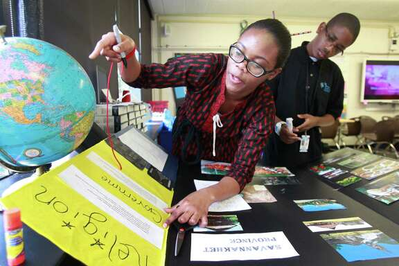 Chisom Anyanwu, 15, left, and Blake Gomez, 14, work on a project about Laos at the HISD's Energy Institute High School  last week.