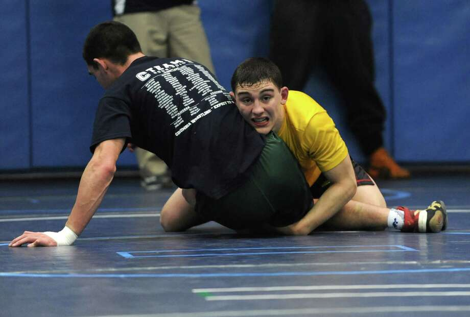 Jim Devine, right, practices with Eliah Golding, a coach with Columbia, during Section II wrestling practice at Columbia High School on Monday, Feb. 24, 2014 in East Greenbush, N.Y.  (Lori Van Buren / Times Union) Photo: Lori Van Buren / 00025859A