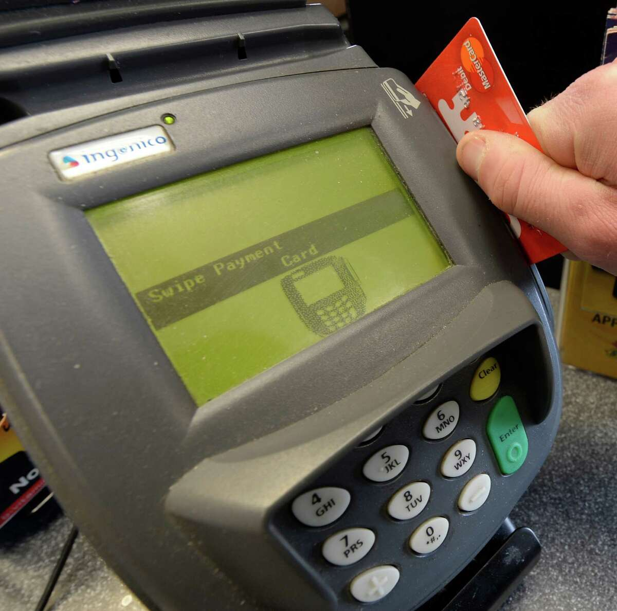 """Photo Illustration of a credit card swipe unit Feb. 24, 2014, in Albany, N.Y. An appeals court on Thursday threw out the conviction of a man state troopers said they caught with a device used to """"skim"""" credit card information.(Skip Dickstein/Times Union)"""