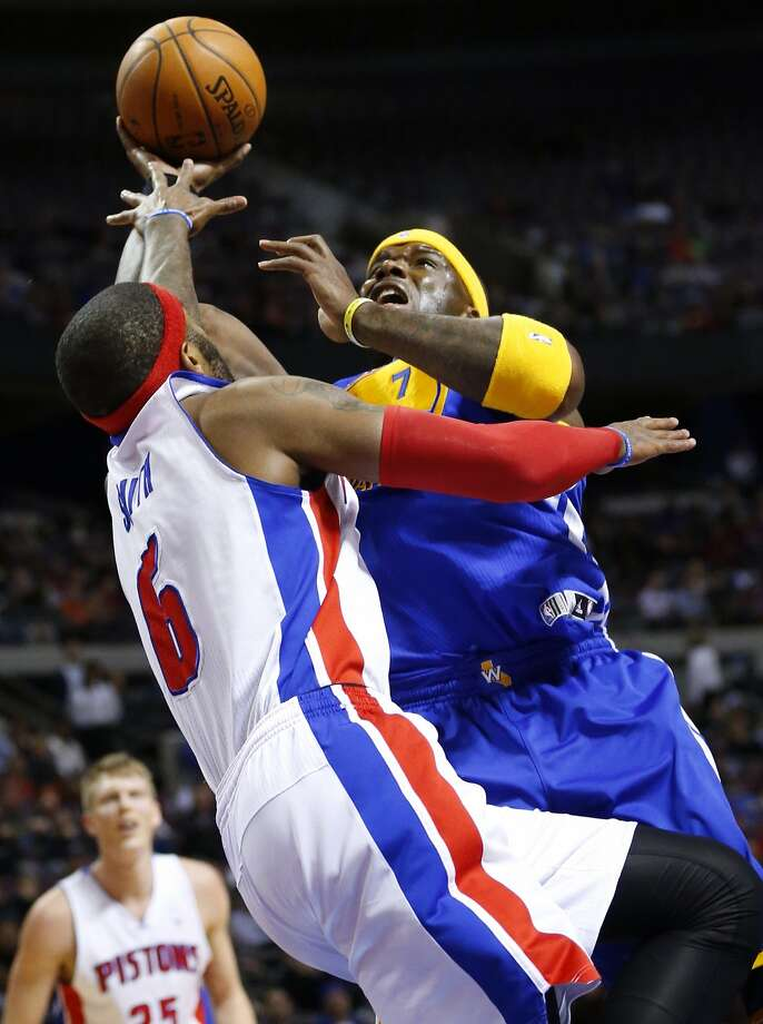 Jermaine O'Neal, who started in place of the ill David Lee, goes at Detroit's Josh Smith. Photo: Rick Osentoski, Reuters