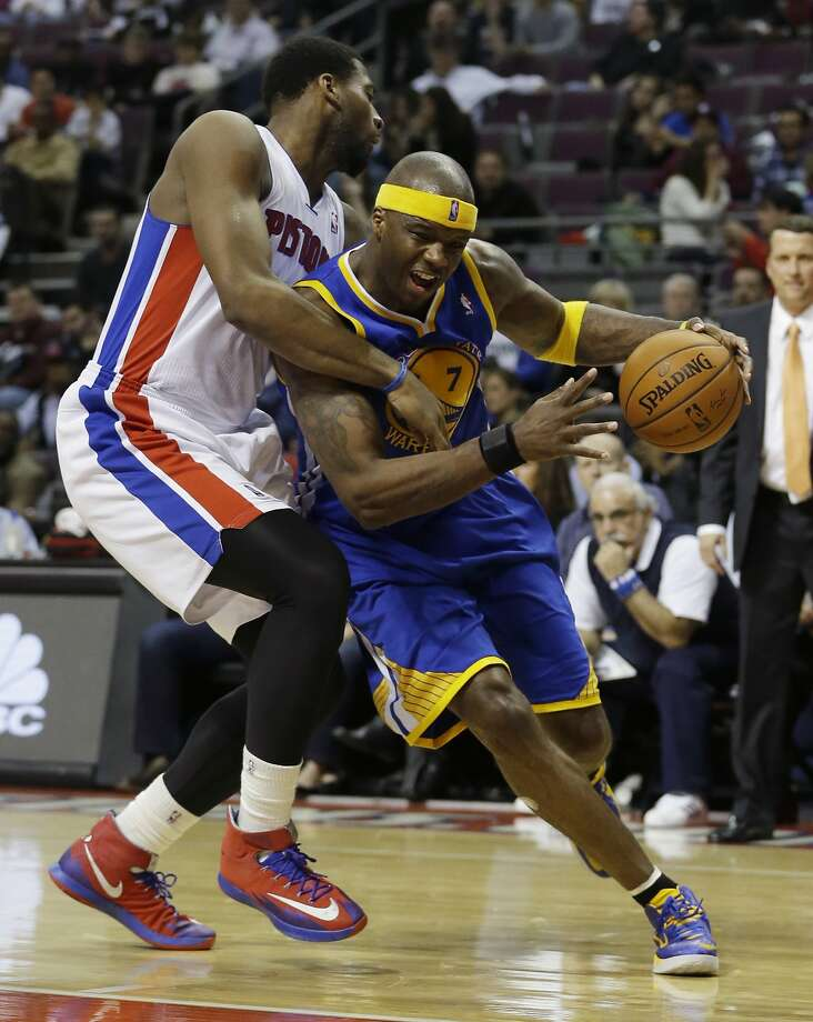 Jermaine O'Neal drives against Detroit's Andre Drummond on his way to a second consecutive double-double in a Warriors victory Monday. Photo: Carlos Osorio, Associated Press
