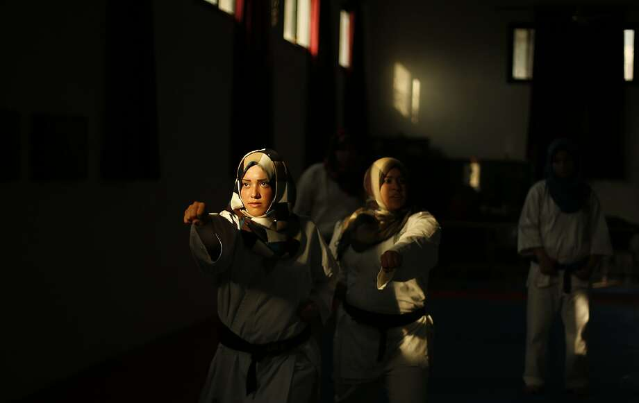 Palestinian girls take part in a karate class at al-Reyadi club in Gaza City February 24, 2014. REUTERS/Suhaib Salem (GAZA - Tags: SPORT SOCIETY TPX IMAGES OF THE DAY) Photo: Suhaib Salem, Reuters