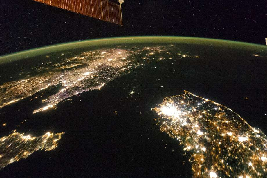 A NASA image released on February 24, 2014 shows a photo taken by the Expedition 38 crew aboard the International Space Station (ISS) on January 30, 2014 of the night view of the Korean Peninsula, and North Korea in the middle is almost completely dark compared to neighboring South Korea (bottom right) and China (top left).  The photograph was cropped and enhanced to improve contrast, and lens artifacts have been removed at source.   REUTERS/NASA-JSC/Handout  (OUTER SPACE - Tags: ENVIRONMENT SCIENCE TECHNOLOGY TPX IMAGES OF THE DAY) ATTENTION EDITORS - THIS IMAGE HAS BEEN SUPPLIED BY A THIRD PARTY. IT IS DISTRIBUTED, EXACTLY AS RECEIVED BY REUTERS, AS A SERVICE TO CLIENTS. FOR EDITORIAL USE ONLY. NOT FOR SALE FOR MARKETING OR ADVERTISING CAMPAIGNS Photo: Nasa, Reuters
