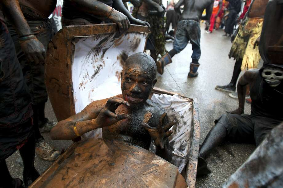 Zombie uprising: If there's any place that has a hard time keeping caskets occupied, it's Haiti at carnival time. In Jacmel, the undead are already popping up all over. Photo: Dieu Nalio Chery, Associated Press