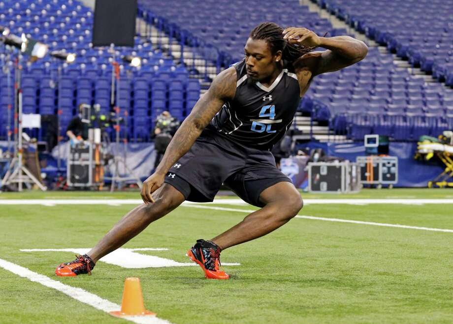 South Carolina's Jadeveon Clowney flashed his impressive athleticism at the combine, but questions remain about how hard a worker he will be in the NFL. Photo: Michael Conroy, STF / AP