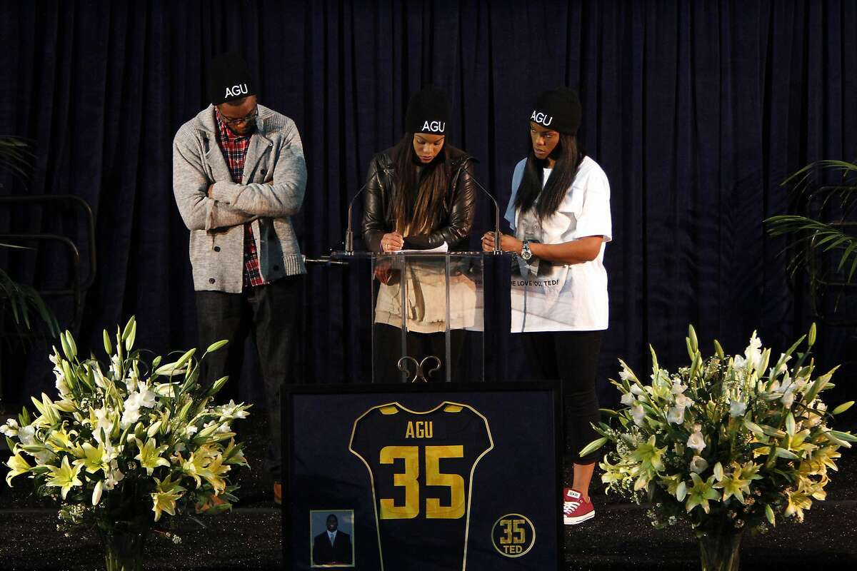 Ted Agu's siblings, Doris Agu, center, Kency, left, and Cynthia, right, speak at a memorial for him at Haas Pavilion at the University of California in Berkeley, Calif., on Monday, February 24, 2014. Agu, a student and football player at Cal, passed away unexpectedly on Friday, Feb. 7th.