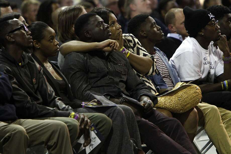 Relatives of Ted Agu watch a video tribute at a memorial service for him at Cal's Haas Pavilion. Photo: Sarah Rice, Special To The Chronicle