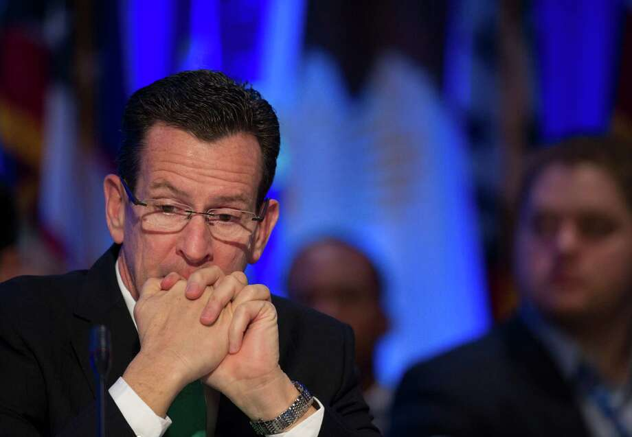 Connecticut Gov.Dannel Malloy participates in a special session on jobs in America during the National Governor's Association Winter Meeting in Washington, Sunday, Feb. 23, 2014. (AP Photo/Cliff Owen) Photo: Cliff Owen, Associated Press / Associated Press