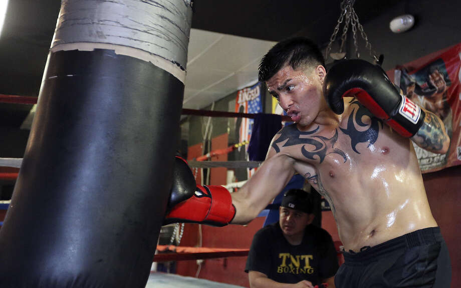 Ivan Najera pounds the heavy bag in preparation for his bout on the Julio Cesar Chavez Jr.-Bryan Vera undercard. Photo: Edward A. Ornelas / San Antonio Express-News / © 2014 San Antonio Express-News