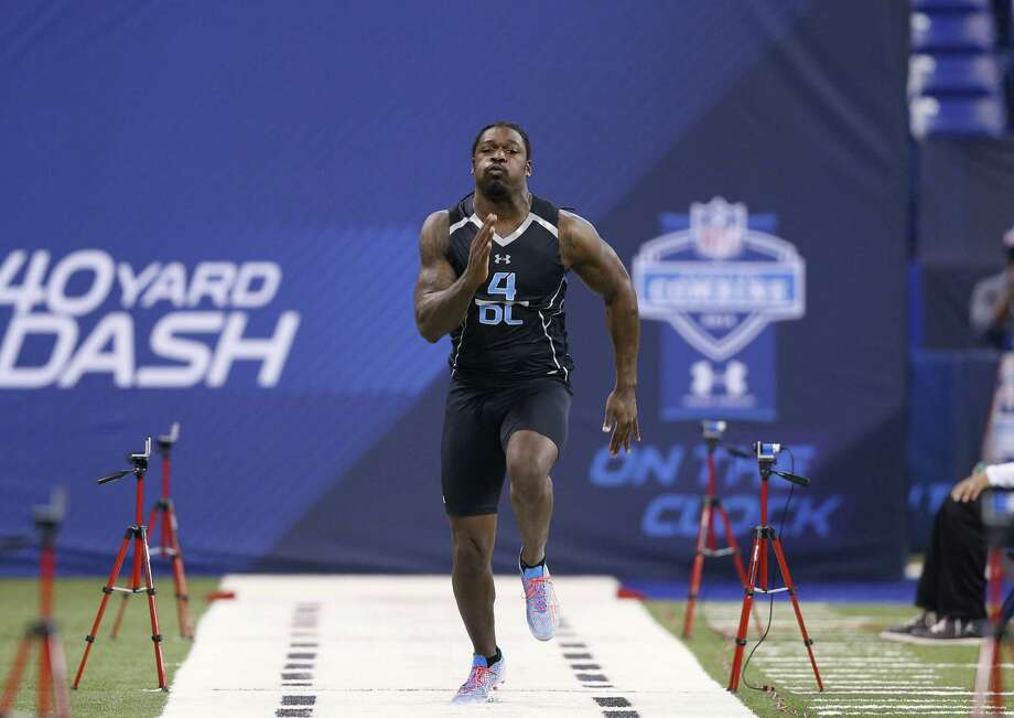 Ex-South Carolina star Jadeveon Clowney ran a faster 40 at the combine than Johnny Manziel. Photo: Joe Robbins / Getty Images / 2014 Getty Images