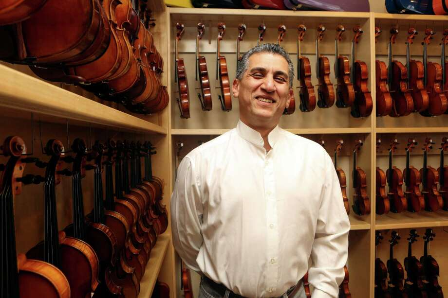 Abbas  Selgi learned to make violins and Iranian instruments in Tehran before he came to the U.S., where he initially had to bus tables and park cars to make a living. He began to make, buy and repair stringed instruments in Austin, before coming to San Antonio where the shop has been a success. His clients are members of the San Antonio Symphony, as well as school districts that rent instruments, along with the Youth Orchestra of San Antonio. Photo: Helen L. Montoya, SAN ANTONIO EXPRESS-NEWS / SAN ANTONIO EXPRESS-NEWS