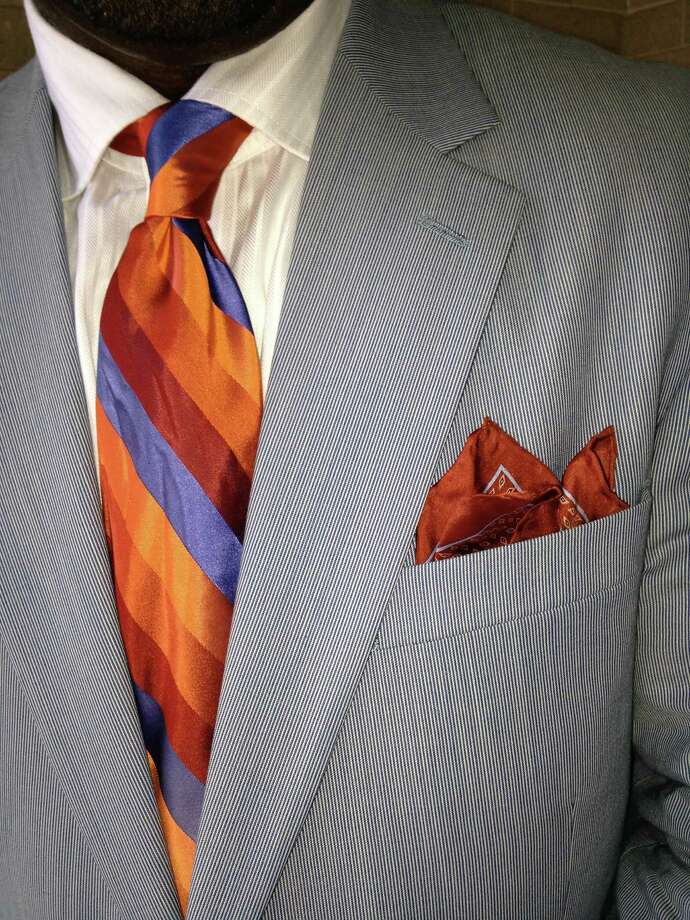 Spring can't come soon enough for Arthur Duke Jr. who is getting a head start with this sharp ensemble: soft blue two-button suit, bright orange-and-blue striped tie and a contrasting pocket square. He tops off the look with a straw striped fedora featuring his tie's colors. Hurry up spring! - Michael Quintanilla Photo: Photo By Michael Quintanilla / San Antonio Express-News