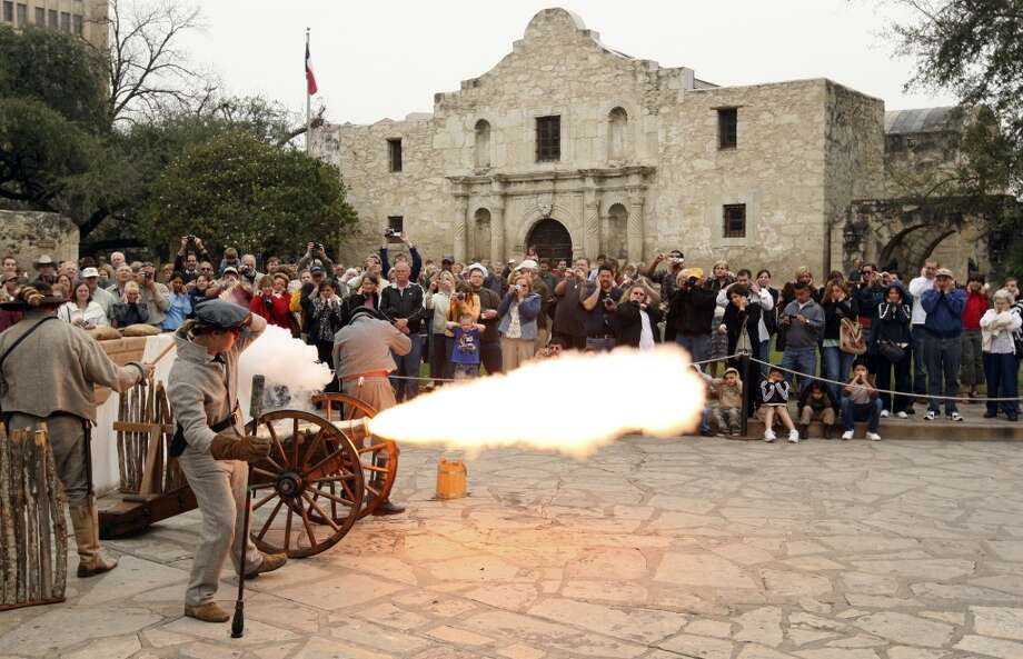 "Members of the San Antonio Living History Association fire a cannon during ""Glory At The Alamo,"" marking the beginning of the Alamo seige, Feb. 23, 2008, at Alamo Plaza. Photo: Express-News, File"