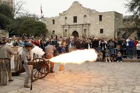 "Members of the San Antonio Living History Association fire a cannon during ""Glory At The Alamo,"" marking the beginning of the Alamo seige, Feb. 23, 2008, at Alamo Plaza."
