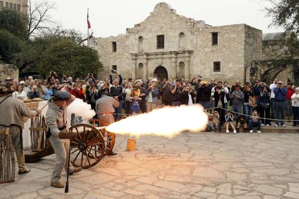 """Members of the San Antonio Living History Association fire a cannon during """"Glory At The Alamo,"""" marking the beginning of the Alamo seige, Feb. 23, 2008, at Alamo Plaza."""