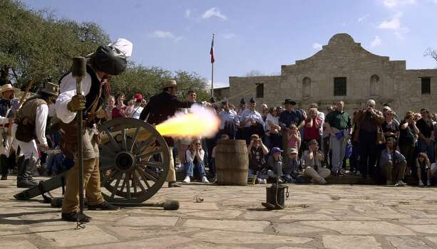 Actors portraying the defenders of the Alamo fire a shot from a smooth bore, black-powdered cannon during a re-enactment in front of the Alamo on Feb. 24, 2001. The re-enactment was done by the San Antonio Living History Association commemorating the 13-day siege of the Alamo. Photo: Kin Man Hui, Express-News