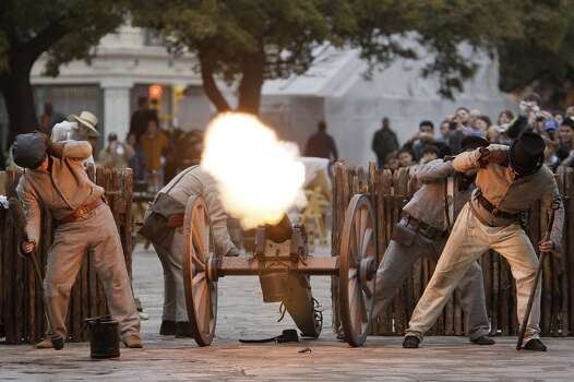 Members of the San Antonio Living History Association shoot a cannon during a reenactment of the fall of the Alamo on March 7, 2010. The men represented the New Orleans Greys, a company of U.S. volunteers who served in the Texas Revolution, according to the Handbook of Texas. Photo: Jerry Lara, Express-News