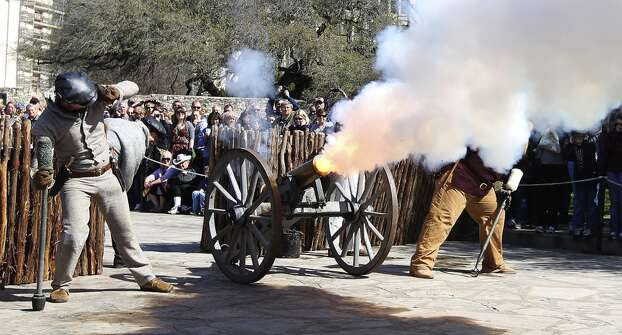 A cannon is fired during a re-enactment of the battle at the Alamo on Saturday, March 5, 2011. Photo: Kin Man Hui, Express-News