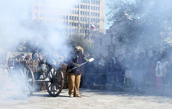Smoke engulfs Alamo Plaza after a cannon is fired during a re-enactment of the battle at the Alamo in Alamo Plaza on Saturday, Mar. 5, 2011. Photo: Kin Man Hui, Express-News