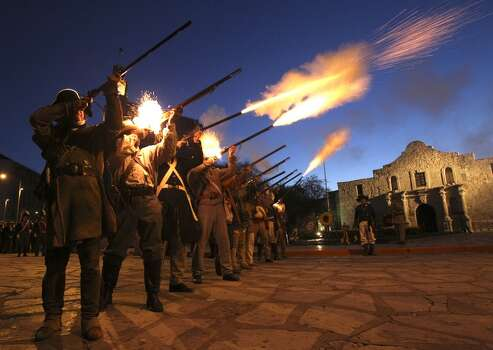 "Members of the San Antonio Living History Association fire rifles in front of the Alamo Sunday March 6, 2011 during the ""Dawn at the Alamo"" ceremony that honors the fallen of the 1836 Battle of the Alamo. Photo: John Davenport, Express-News"