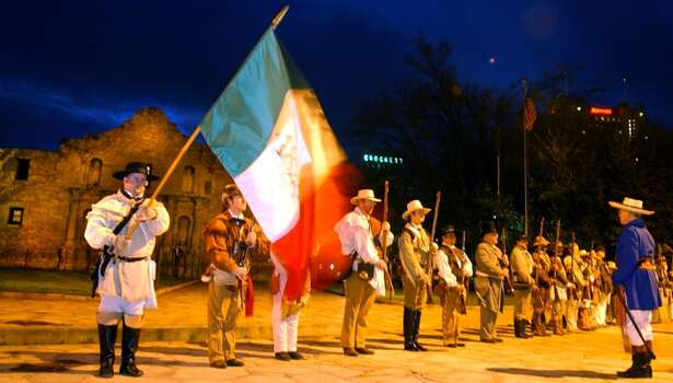 "San Antonio Living History Association re-enactors stand at attention during the annual ""Dawn at the Alamo"" ceremony commemorating the 167th anniversary of the fall of the Texas shrine. Photo: John Davenport, Express-News"