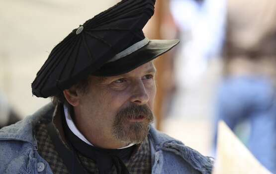 Dr. Bruce Winders, historian and curator at the Alamo, dresses in period clothing while joining other living historians in Alamo Plaza on March 2, 2013. Photo: Kin Man Hui, Express-News