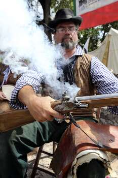 Rob Wilkerson of the San Antonio Living History Association test fires a flint he made for a rifle as the Save Texas History symposium hosted by theTexas General Land Office on Sept. 7, 2013. Photo: Tom Reel, Express-News