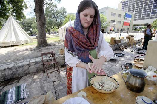 Amanda Maloney of the San Antonio Living History Association makes corn tortillas in Alamo Plaza as the Save Texas History symposium is hosted by theTexas General Land Office on Sept. 7, 2013. Photo: Tom Reel, Express-News