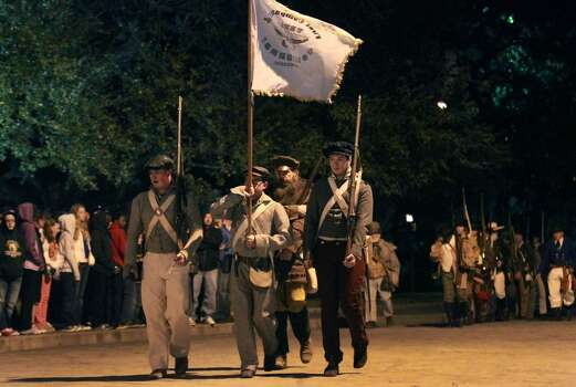 "Members of the San Antonio Living History Association march in front of the Alamo during the ""Dawn at the Alamo"" ceremony March 6, 2013, on the 177th anniversary of the battle for Texas independence. Photo: John Davenport, Express-News"
