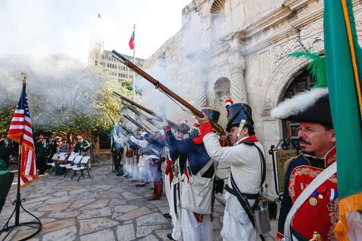 A musket volley is fired by living history re-enactors during a wreath-laying ceremony at the Alamo by the Special Forces Association on June 29, 2013. Photo: Marvin Pfeiffer, Express-News