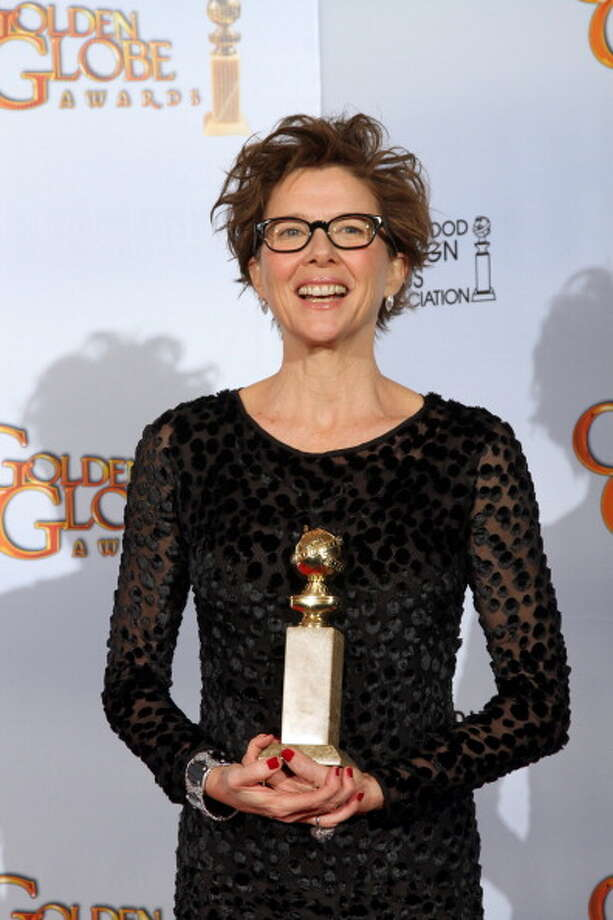 Actress Annette Bening poses with her award for Best Performance by an Actress in a Motion Picture (Musical Comedy) for 'The Kids Are All Right' at the 68th annual Golden Globe awards, January 16, 2011. She lost that year to Natalie Portman in BLACK SWAN. Photo: AFP, AFP/Getty Images / 2011 AFP