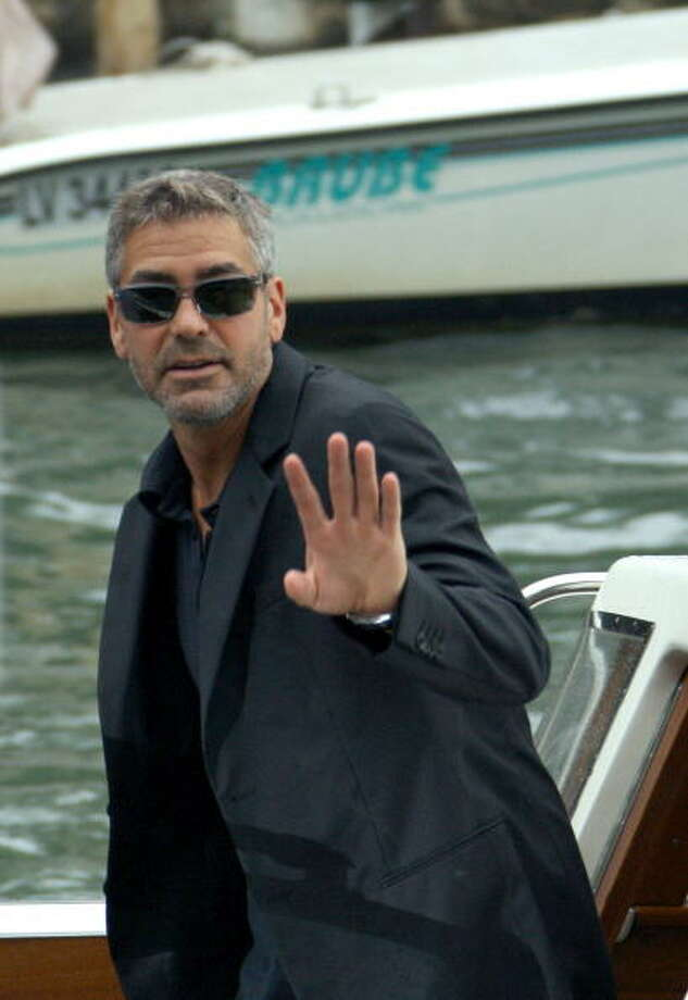 "Georges Clonney waves as he arrives for a the press conference of the movie ""Michael Clayton"" at the Venice Lido, 31 August 2007, during the 64th Venice International Film Festival. Clooney went on to lose the best actor Oscar to Daniel Day-Lewis THERE WILL BE BLOOD.  He shouldn't have. Photo: CHRISTOPHE SIMON, AFP/Getty Images"