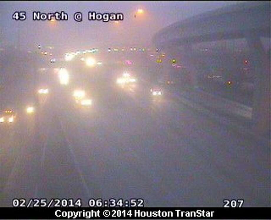 Foggy conditions blanket areas along the North Freeway near Hogan Tuesday morning. Photo: Houston Transtar