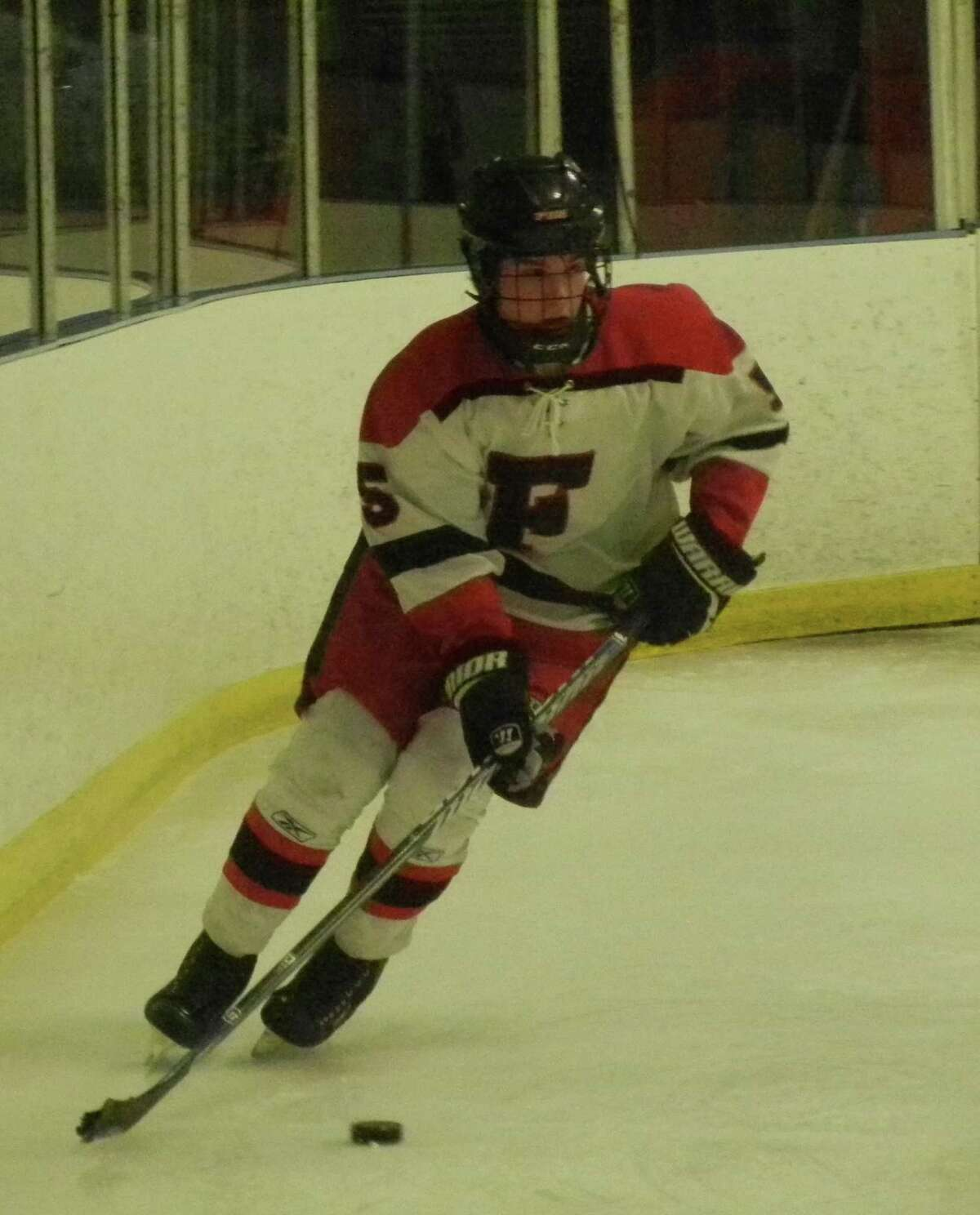 Fairfield co-op's Trevor Demilt behnd the goal in his team's 7-1 FCIAC boys ice hockey victory over Stamford on Monday, Feb. 24 at the Wonderland Of Ice in Bridgeport. He had a goal and an assist.
