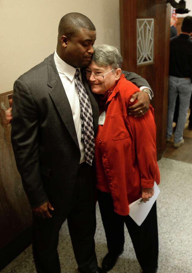 Jane Birge hugs Langston Adams after he was voted in as interim judge for court No. 3 on Monday. Adams will be succeeding the recently deceased John Paul Davis while Birge succeeded Lolita Ramos as District Clerk in October. Photo taken Monday, February 24, 2014 Guiseppe Barranco/@spotnewsshooter Photo: Guiseppe Barranco, Photo Editor